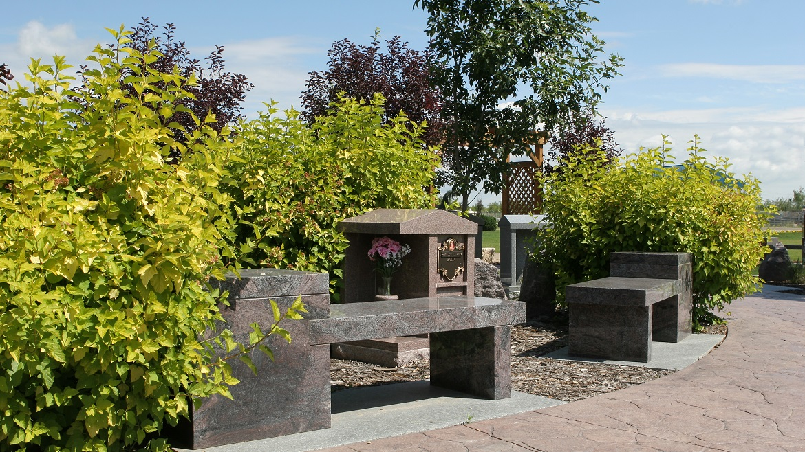 Memorial benches and plaques throughout cemetery