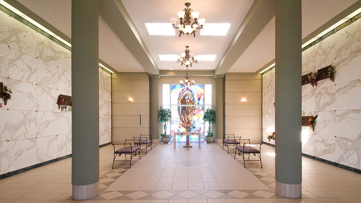 Indoor glass-front columbarium niches and mausoleums open year round